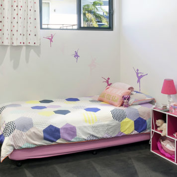 Child's bedroom with ballerinas on the wall