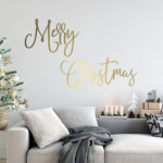Scandinavian style living room with gold decal on the wall