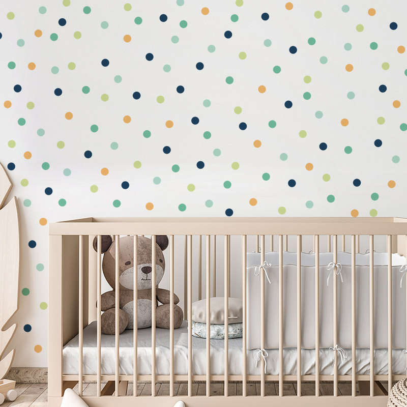 Spots wall stickers on a wall in front of a cot
