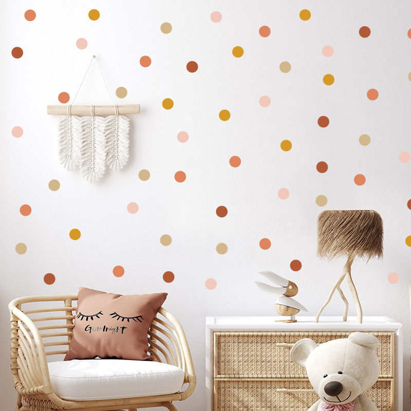 Spots wall stickers on a wall in front of cane furniture