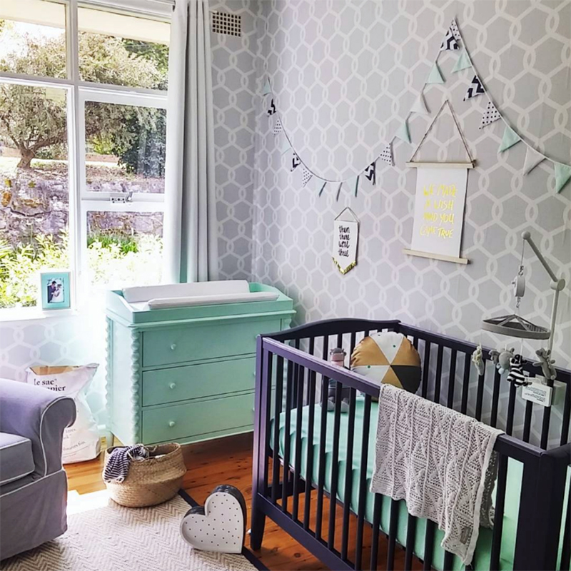 Nursery with cot and wallpaper