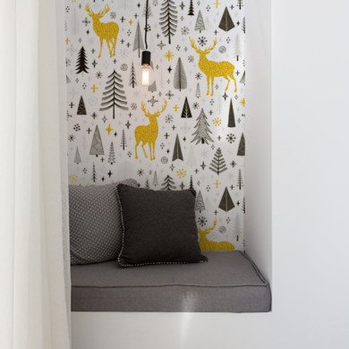 Styled reading nook with grey cushions and single pendant light
