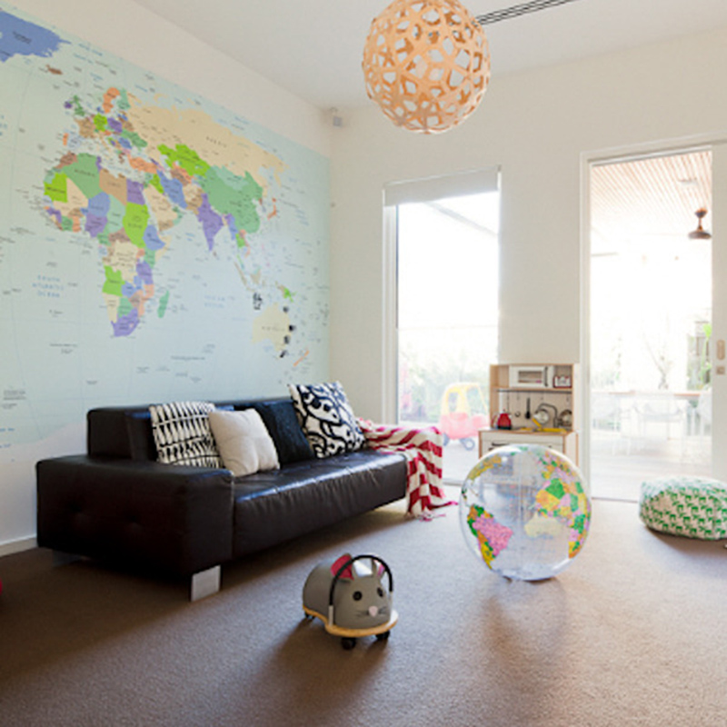 world map mural in a living area