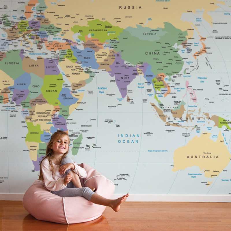 world map mural with a girl in a beanbag sitting in front