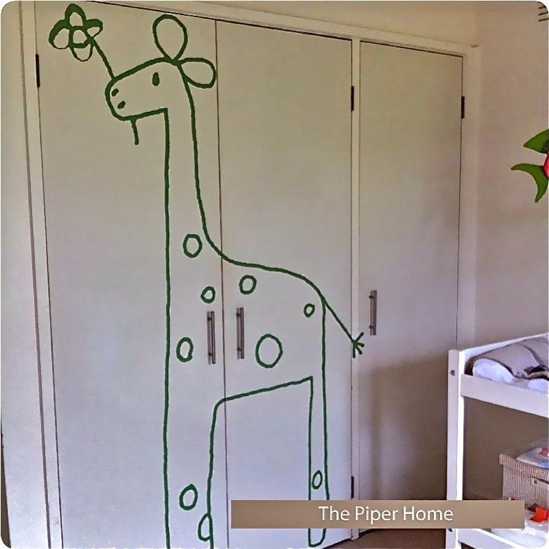Gemmi The Giraffe Removable Wall Stickers installed on the door cabinet