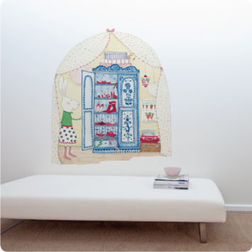 Rubys Wardrobe Removable Wall Stickers behind a white bed