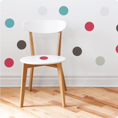 Spots removable wall sticker behind a chair with pink spot