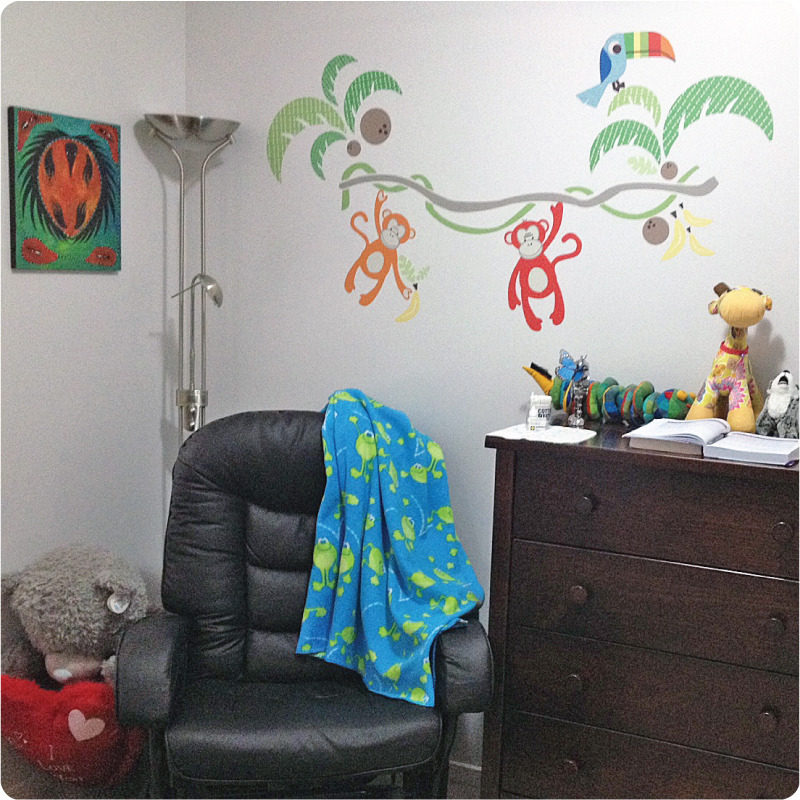 Jungle Canopy Removable Wall stickers behind an office chari and brown cabinet