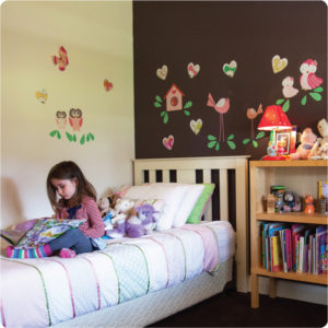 Love Struck Removable Wall stickers with a little girl reading books behind