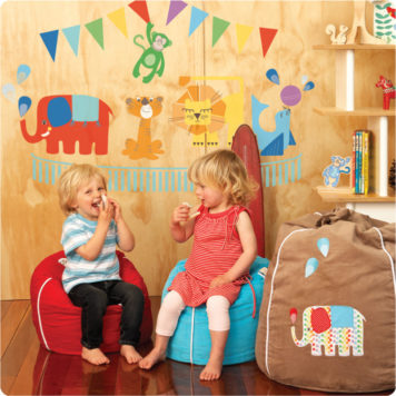 Circus removable wall stickers Cocoon Couture with 2 cute little kids in front sitting on a bean bag