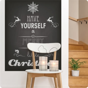 Christmas removable poster behind a wooden chair with 2 lamps on top