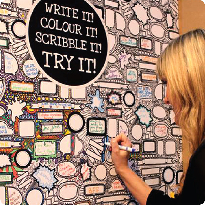 Scribble It Removable Panel with a girl writing on it