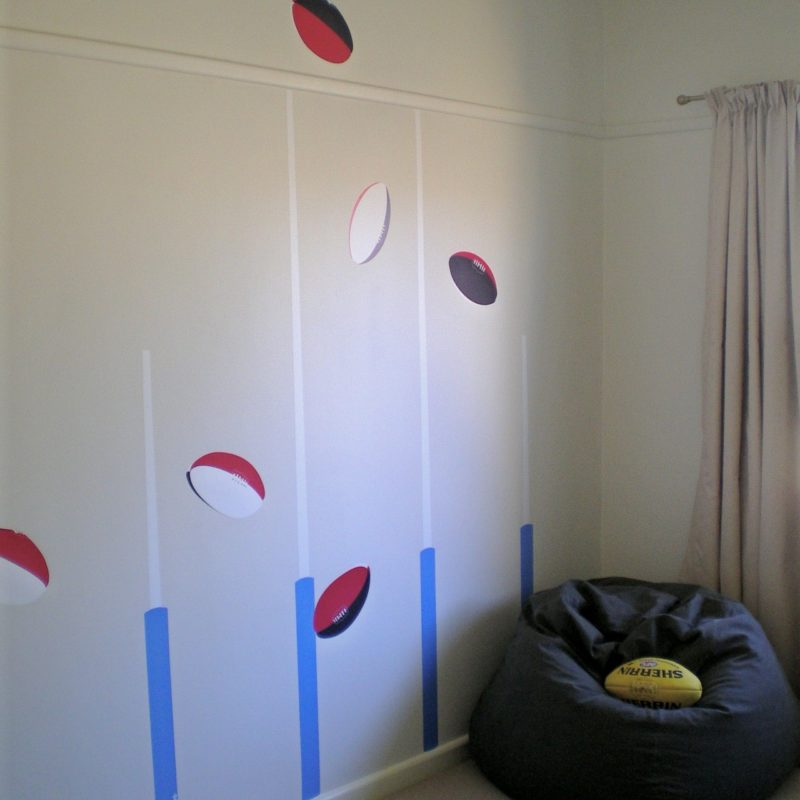 Footy removable wall stickers with a bean bag chair in front
