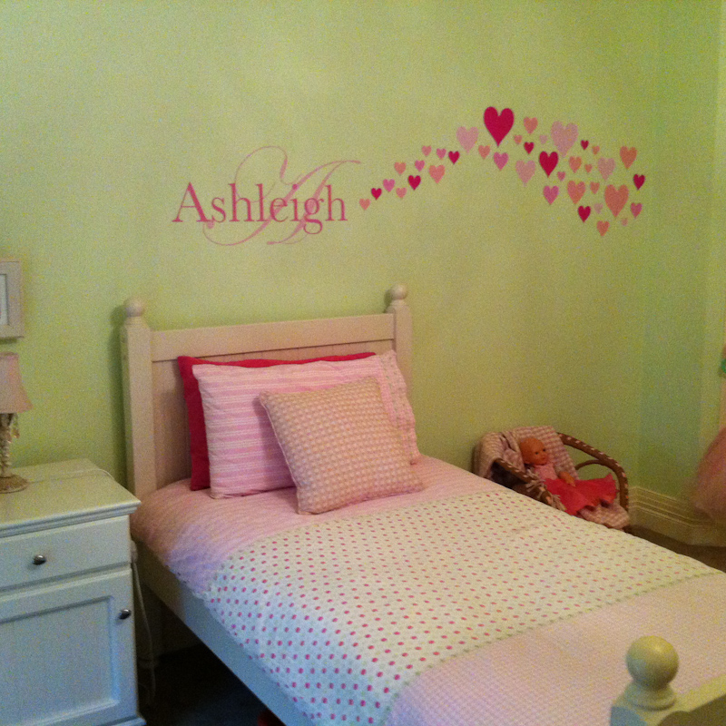 Hearts Removable Wall Stickers with child name Ashleigh on the wall