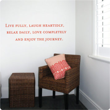 Live quote removable wall sticker in the behind a brown chair