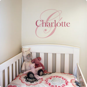 Monogram Removable Wall Stickers with child name Charlotte behind a white crib