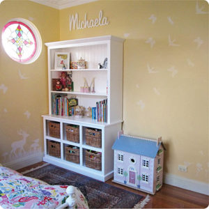 Child name Michaela behind kid's cabinet
