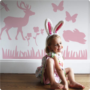 Nursery Animals Removable Wall Stickers with a little girl wearing bunny headband and smiling in front
