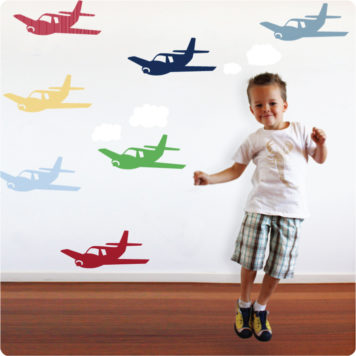 Planes removable wall decals with a little boy dancing in front