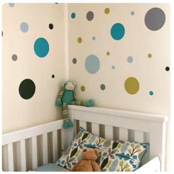 Polkadots removable wall stickers behind a white crib