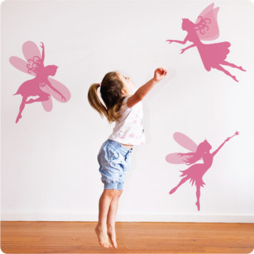 Pretty Fairies Removable Wall Stickers with a little girl in front trying to imitate them