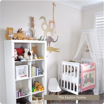 Jungle stack removable wall stickers by Printspace behind kids cabinet, chair and white crib