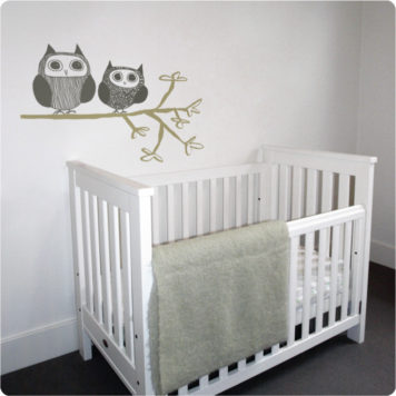 Owl Couple Removable Wall Stickers behind a white crib