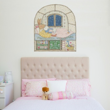 Stargazing With Ruby Removable Wall Stickers behind a bed