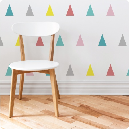 Triangle removable wall stickers decals behind a wooden chair