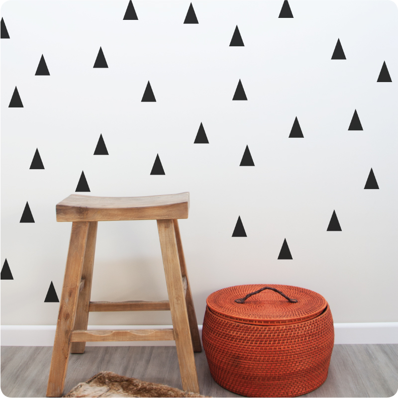 Triangle removable wall stickers decals behind a wooden chair and basket