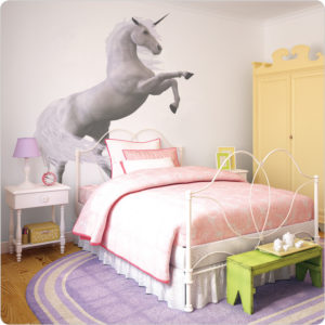 Horse wall decal behind a white bed and white side table