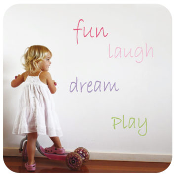 Words removable wall sticker with a little girl playing skateboard in front