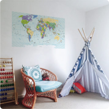 World Map Removable Poster behind a chair and tent