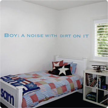 Boy Definition removable quote wall stickers behind a bed
