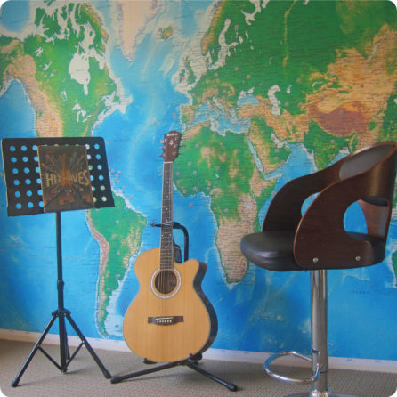 World Map removable geographical mural with guitar and chair in front