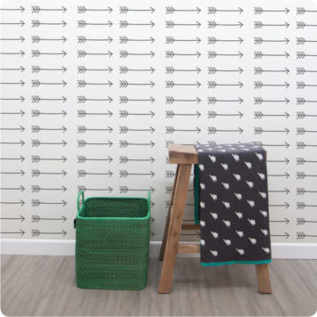 Arrows removable wallpaper Australia for walls with wooden stool in front