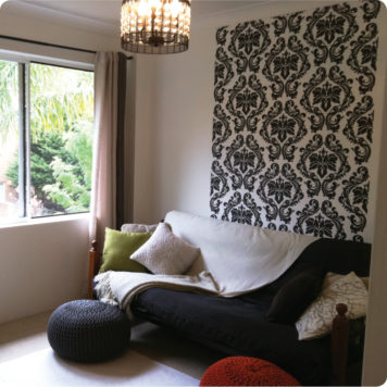 Damask removable wallpaper Australia in Baroque design behind a sofa