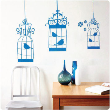 Birdcage removable wall stickers behind a chair and cabinet