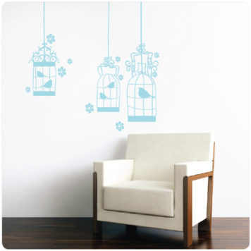 Birdcage removable wall stickers behind a sofa