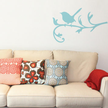Blue wren removable wall sticker behind a sofa