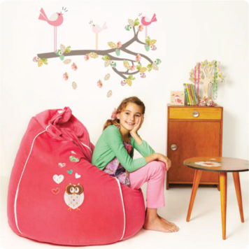 Enchanted Branch removable wall stickers by Cocoon Couture with a pretty girl smiling in front