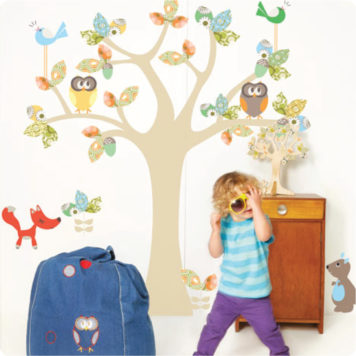 Enchanted Tree removable wall stickers by Cocoon Couture with little boy wearing shade in front