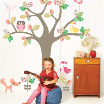 Enchanted Tree removable wall stickers by Cocoon Couture with little girl playing guitar in front