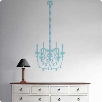 Chandelier removable wall sticker behind a lamp shade on top of a cabinet