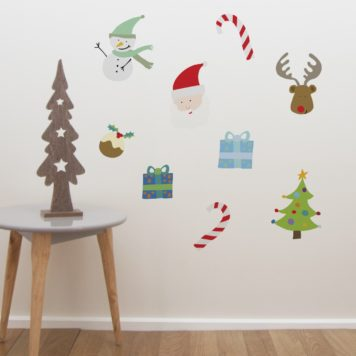 Christmas Friends removable wall stickers behind a round table with christmas tree on top