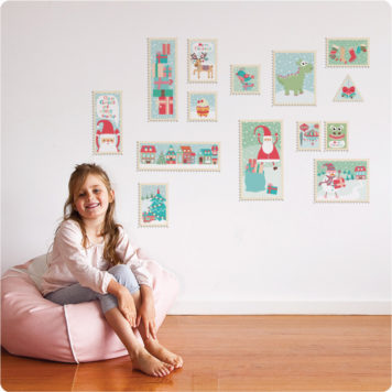 Christmas Stamps removable wall stickers behind with a pretty smiling girl sitting