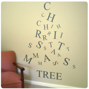 Christmas tree removable wall sticker behind a chair