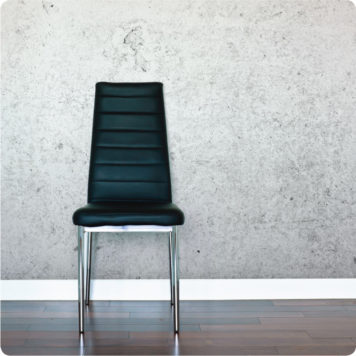 Concrete removable wallpaper Australia with dark green chair in front