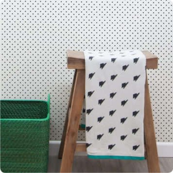 Dotty removable wallpaper Australia with wooden chair and basket in front