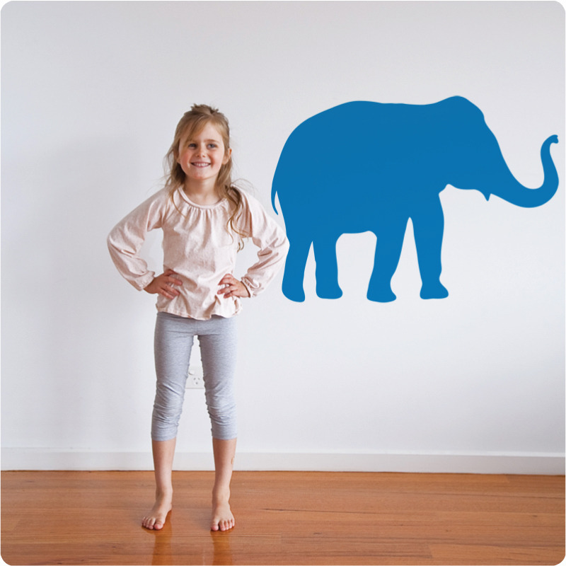 Elephant removable wall stickers with a girl smiling in front